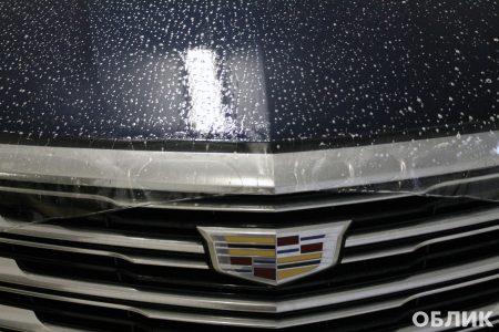 Процесс оклейки капота на Cadillac XT5